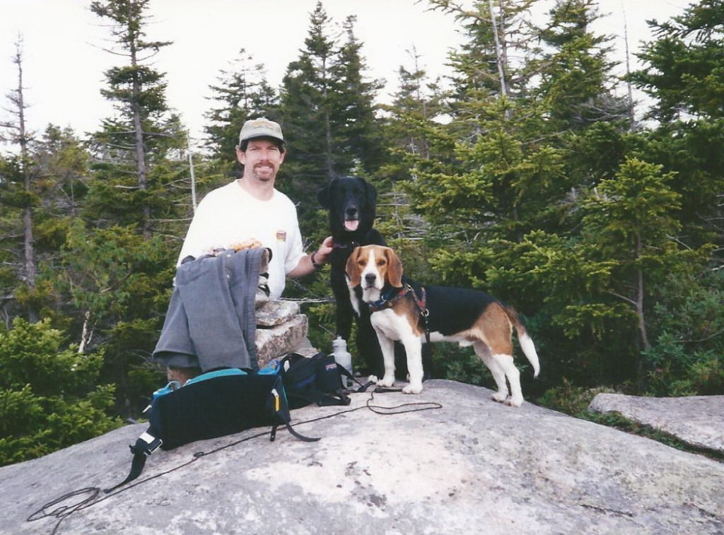 Maggie and Kobi with Dad on a hike.